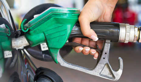 A petrol nozzle filling up a car