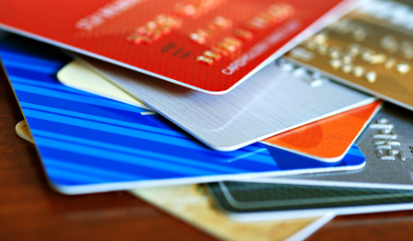 A stack of reward and cashback credit cards
