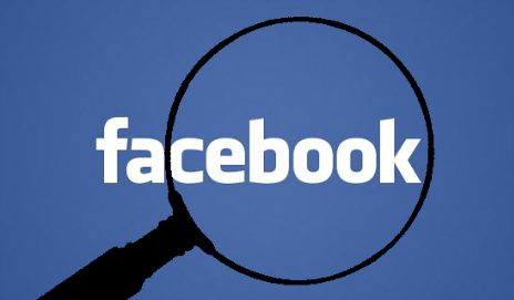 Facebook with magnifying glass