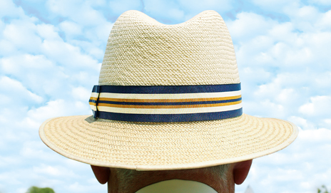 An elderly gentleman wearing a sun hat