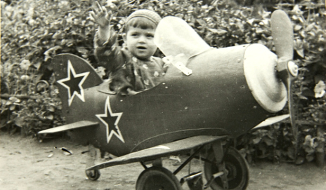 A baby in a toy plane