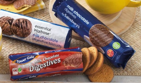 Three packets of chocolate digestive biscuits