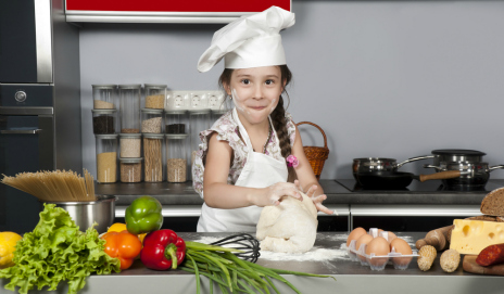 Little girl playing at being a chef