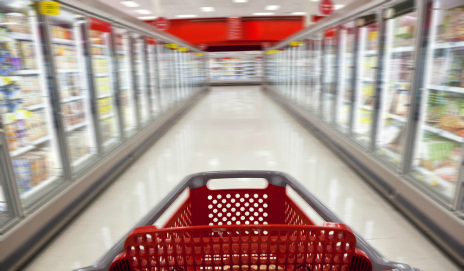 A shopping trolley in a supermarket aisle