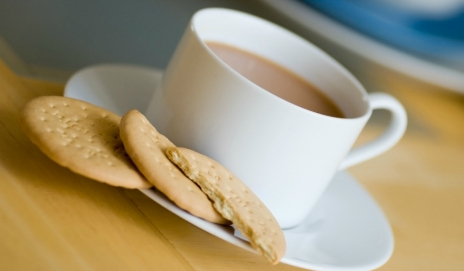 A cup of tea with some biscuits