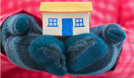 A tiny house in someone's hands