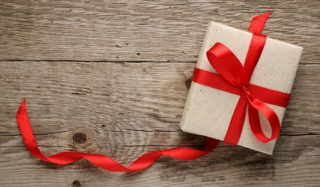 A parcel tied with a red ribbon