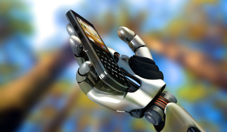 A robotic hand holding a mobile phone