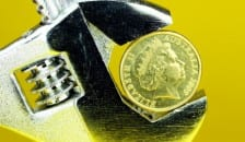 Spanner with pound coin