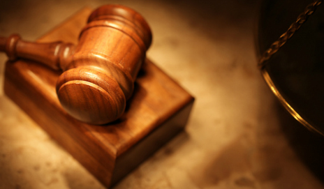 A judge's gavel and block