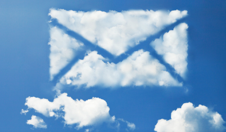 An email made of clouds in a blue sky