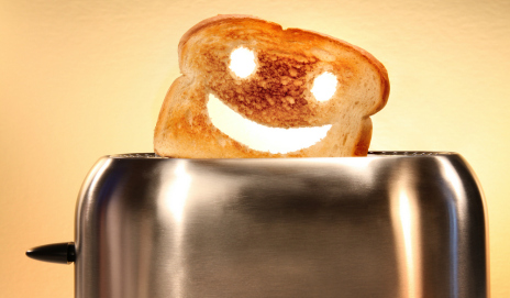 A slice of toast with a happy face