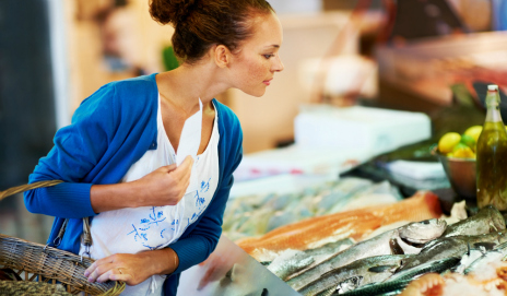 A woman shopping at a fish counter