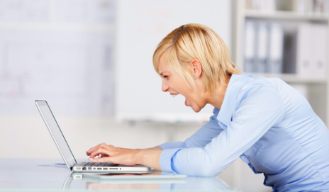 Woman writing letter of complaint on her laptop