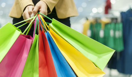 A woman holding multiple shopping bags