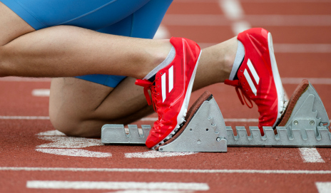 A pair of feet in the starting blocks