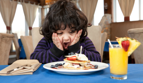 Child eating pancakes