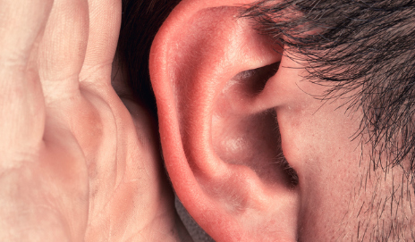 Man listening with ear