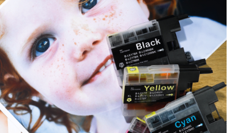 Printer ink cartridges on a photo of a child