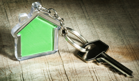 A key with a house shaped keyring
