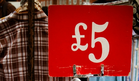 £5 sign next to second-hand clothes