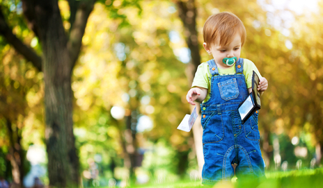 Child with wallet in park