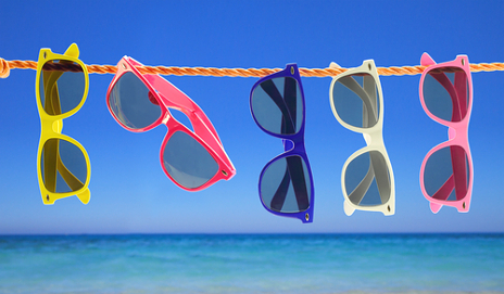 Colourful sunglasses on a washing line