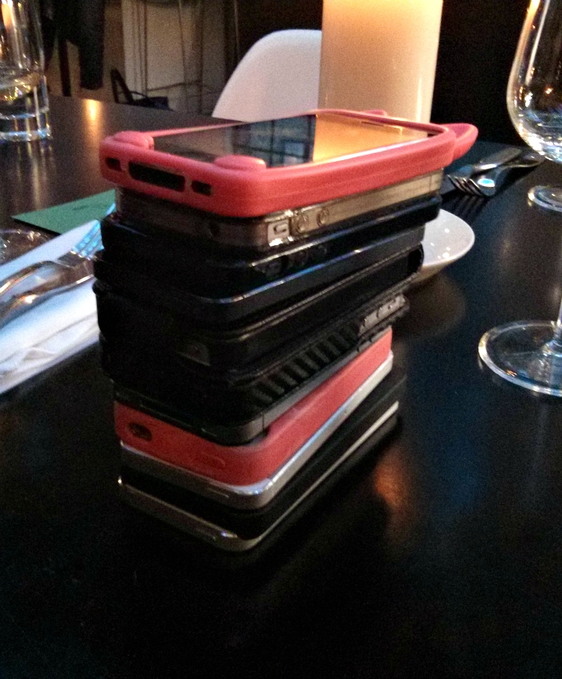 Stack of iPhones in restaurant