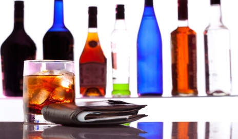 Wallet on bar with drinks