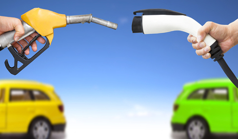 Petrol pump facing electric car wire