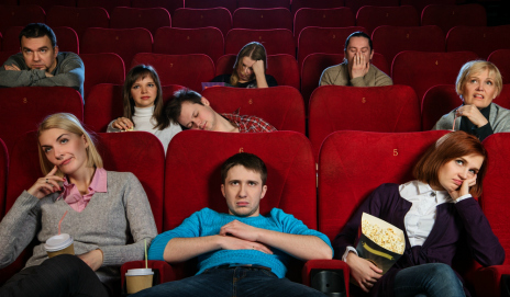 Bored people in a cinema