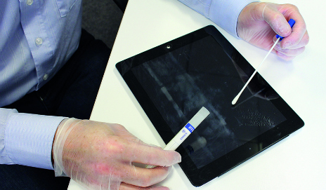 Tablet PC being swabbed