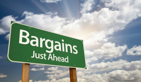 Bargains just ahead on road sign
