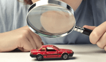 Car and magnifying glass