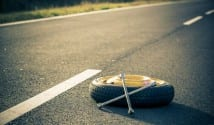 Spare wheel lying in the road