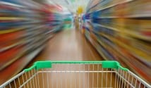 Trolley in supermarket aisle