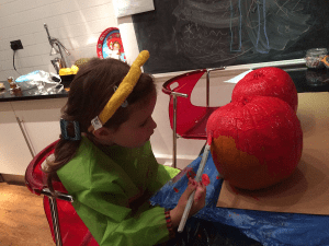 Painting the pumpkins red!