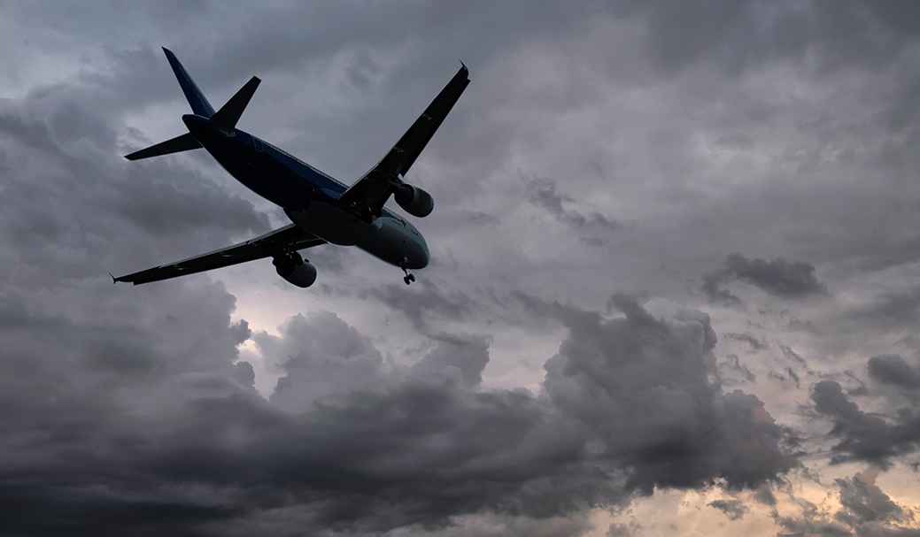 An airplane flying in cloudy weather