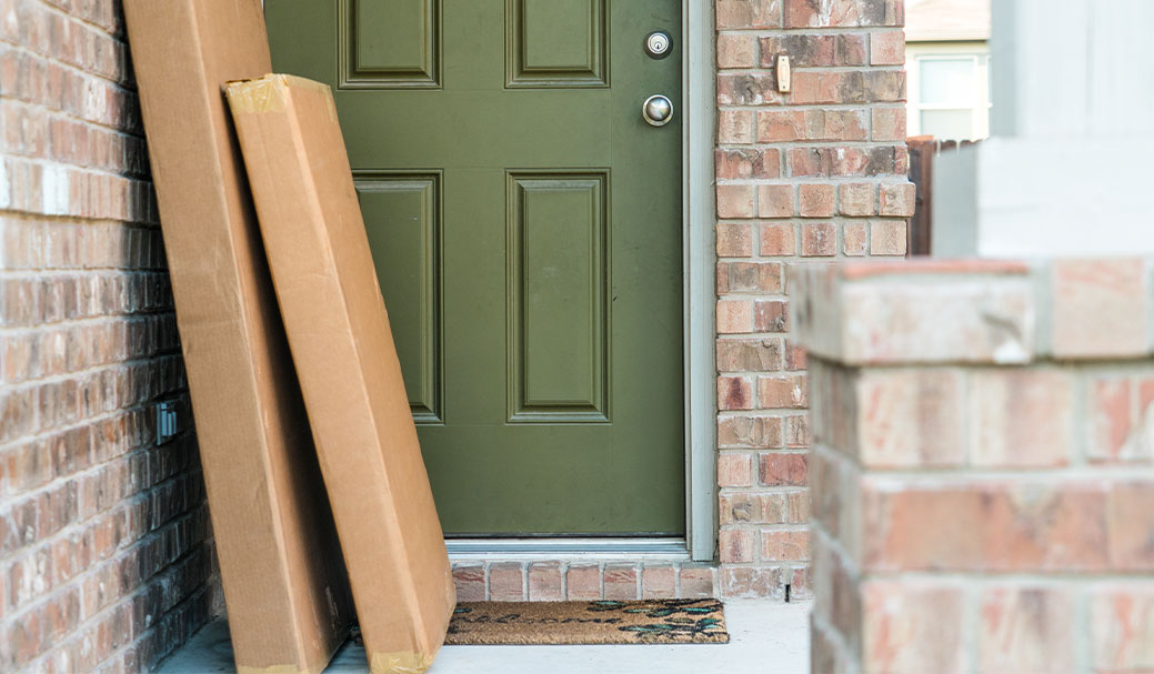Two large deliveries are left awkwardly next to someone's front door